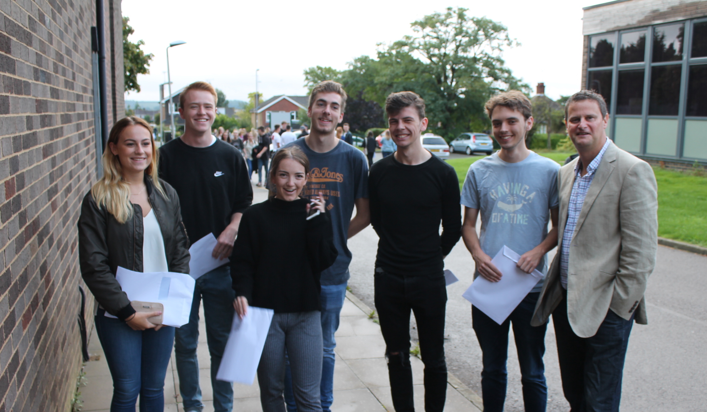 Amy Hayward, Asher Winter, Gina Harland, Harry Thompson, James Milsom, Fergus Longley celebrate their A-Level Results with Principal Richard Taylor